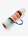 stripe yoga mat shown rolled up with carrying handle