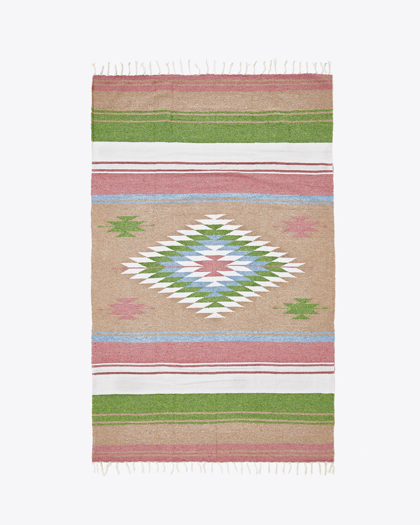 woven blanket with an aztec design featuring pink, tan, and green