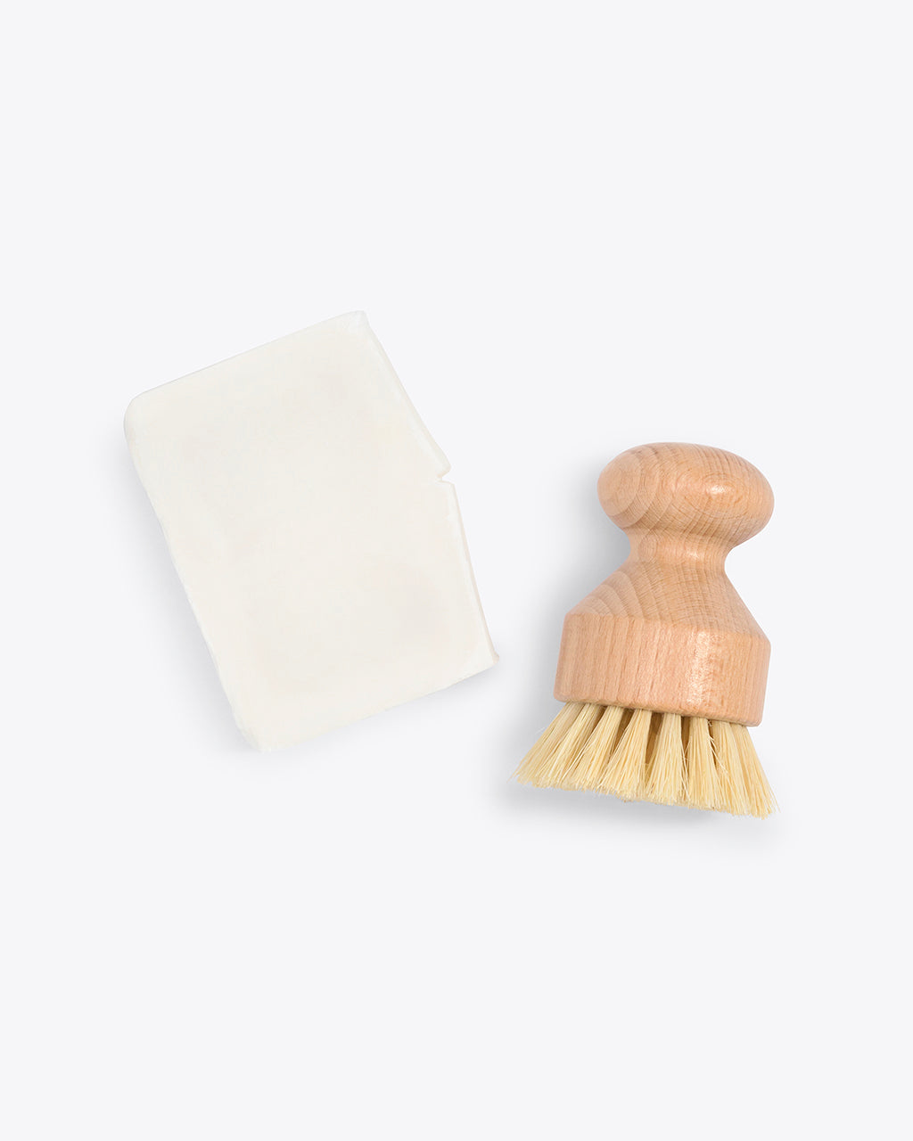 wooden hand held dish brush shown with vegan dish soap bar