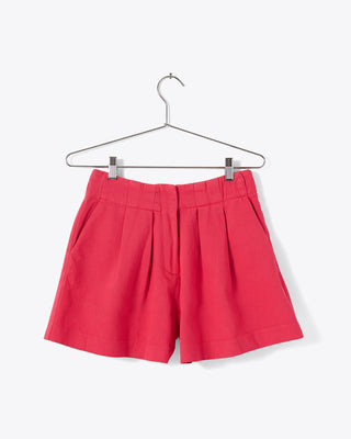 pink coral shorts with pleats and pockets