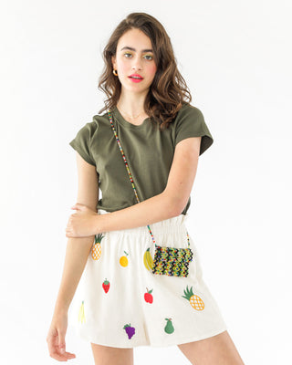 white shorts with a embroidered fruit pattern shown on brunette model