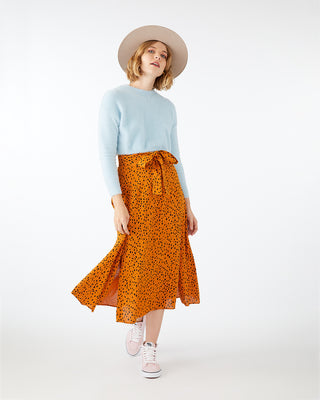 Leopard print wrap skirt with side slit.