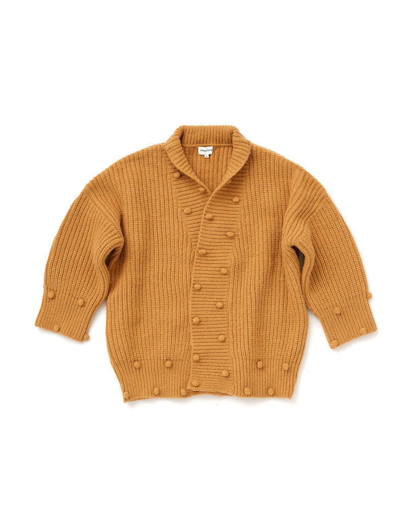 mustard color cardigan with pompom feature