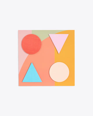 Set of sticky pink triangle, blue triangle, light pink circle and orange circle notes on multi-colored backer