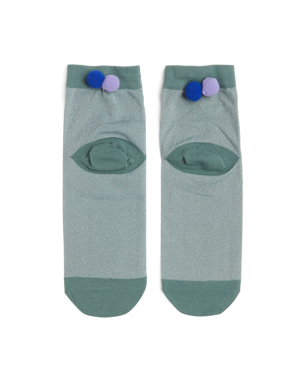 Flat shot of green tonal crew socks with purple pom poms on the back ankle.