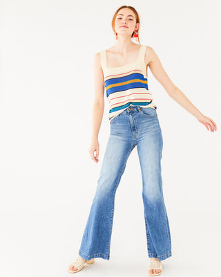 light wash flare jeans paired with a stripe tank shown on model