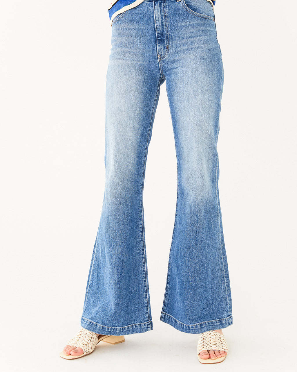 light wash flare jeans with a high waist fit