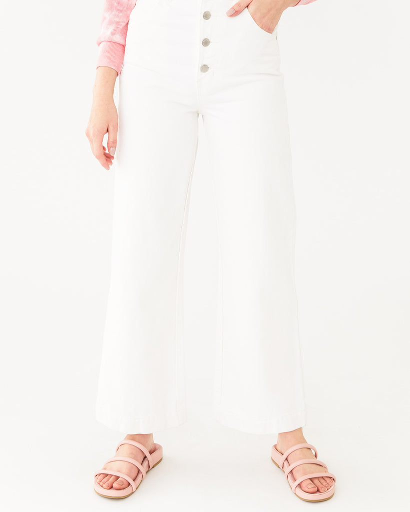 vintage white wide leg ankle jeans paired with a pink sandal shown on model