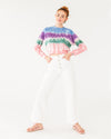 vintage white wide leg ankle jeans paired with a pink sandal and a crop tie dye sweater shown on model