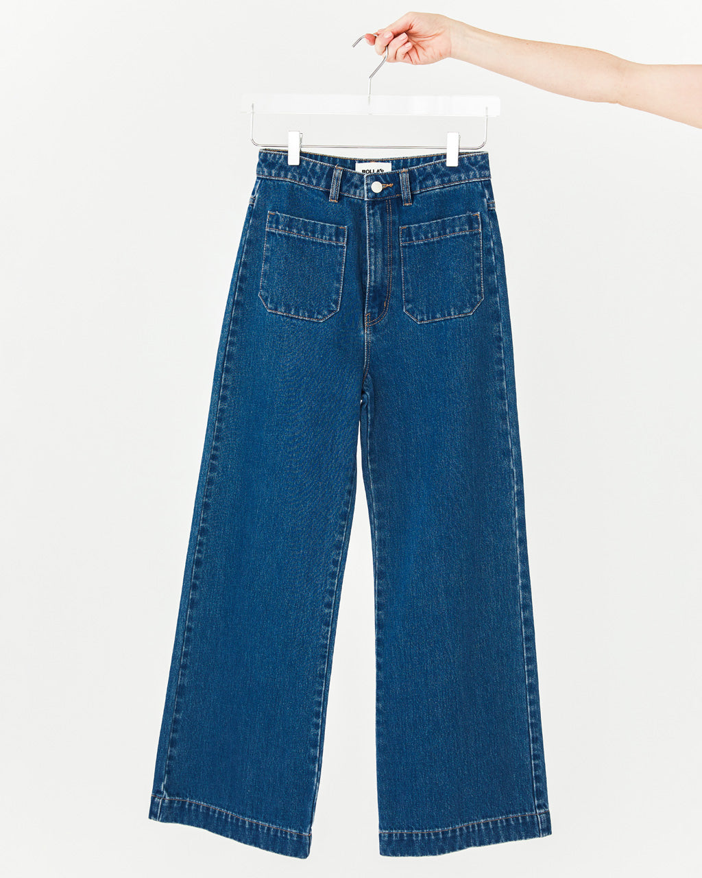 Indigo blue jeans with front patch pockets, high waist, wide leg and a zip fly