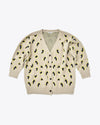 tan cardigan with a leopard print design