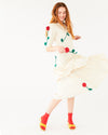 off white below the knee, quarter length sleeve dress with 3 dimensional rose vines shown on model