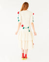 off white below the knee, quarter length sleeve dress with 3 dimensional rose vines, and a layered bottom shown on model