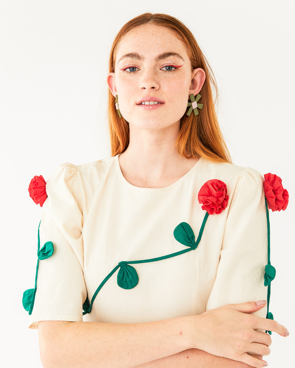 off white quarter length sleeve dress with 3 dimensional rose vines shown on model