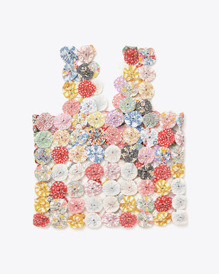 cropped tank top comprised of small, fabric rosettes in multicolored patterns and colors.