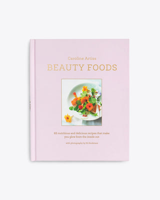 beauty foods book with a pink cover featuring an image of food