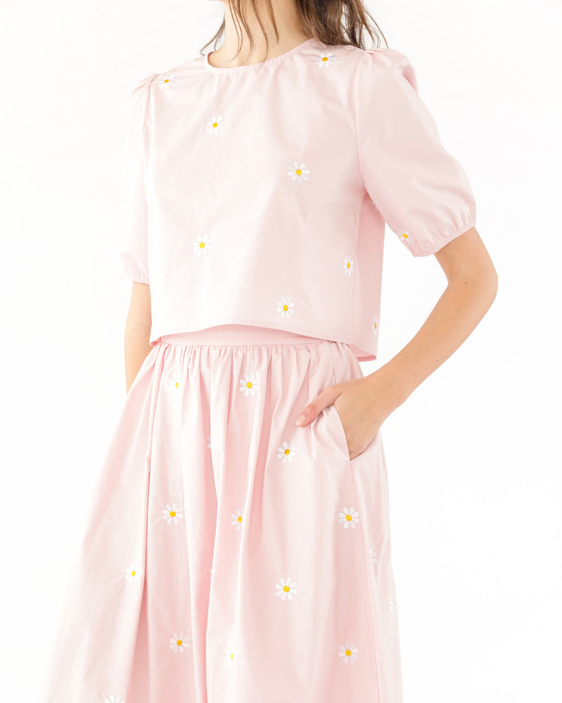 light pink daisy embroidered skirt with side seam pockets shown on model