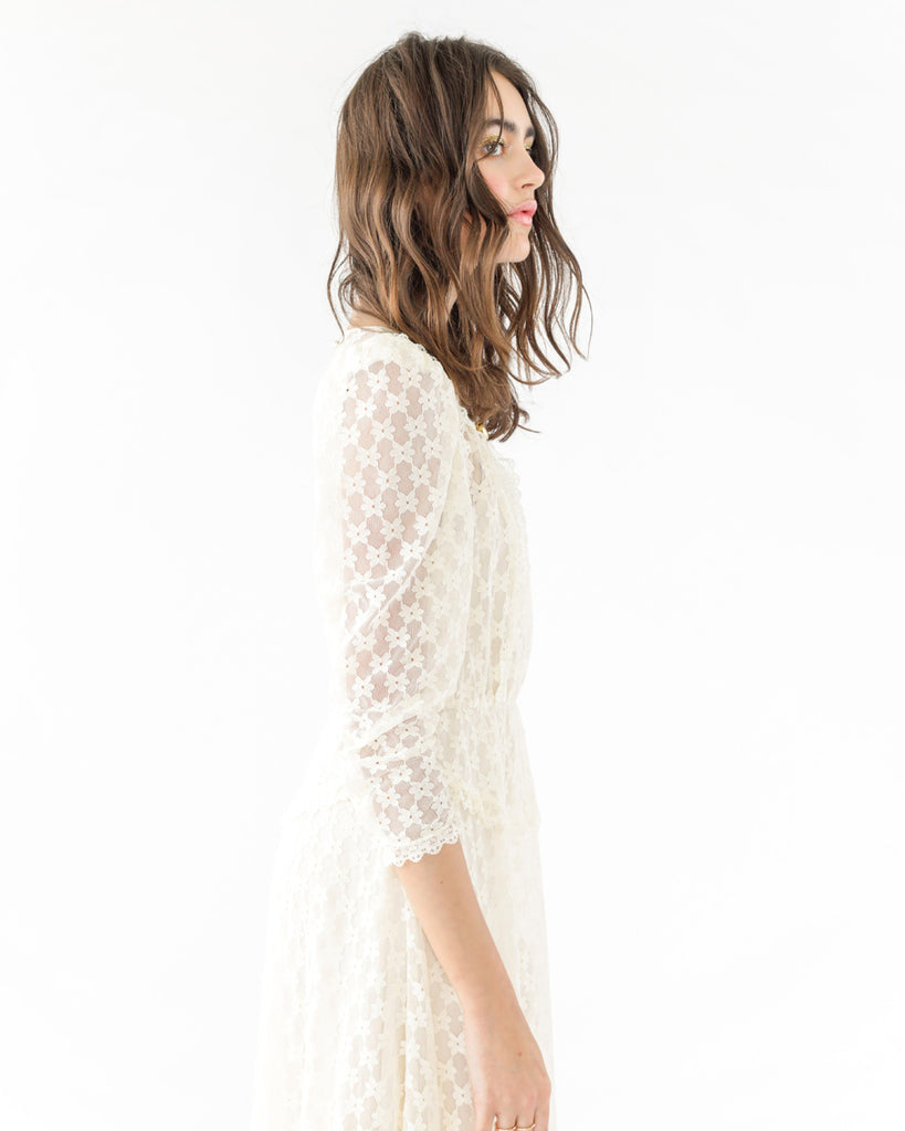 white lace dress with quarter length sleeves shown on brunette model