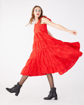 Red floral textured fabric likely lady dress.