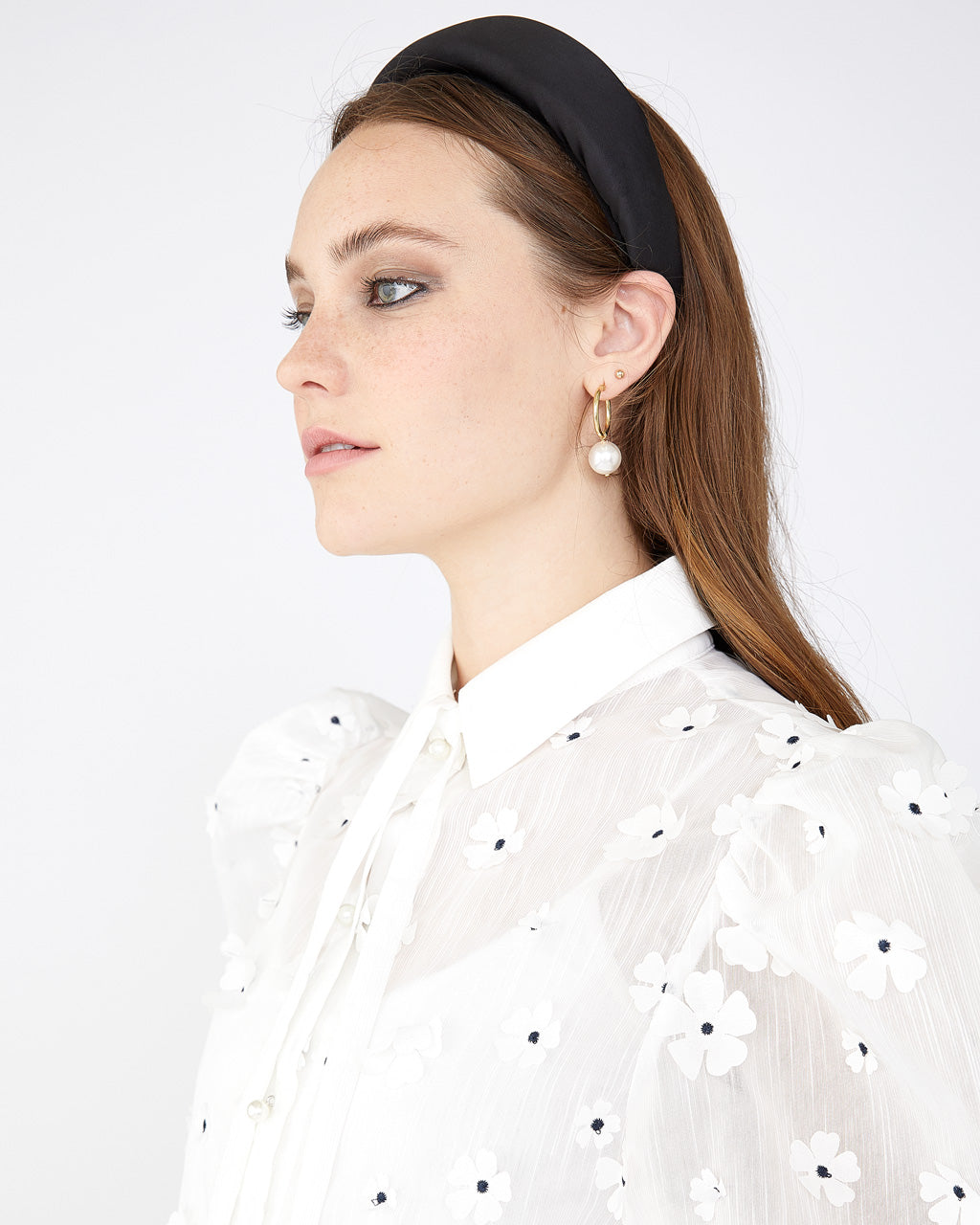 White blouse with puffy sleeves and neck bow