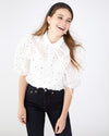 White blouse with an all over floral design and ruched sleeves