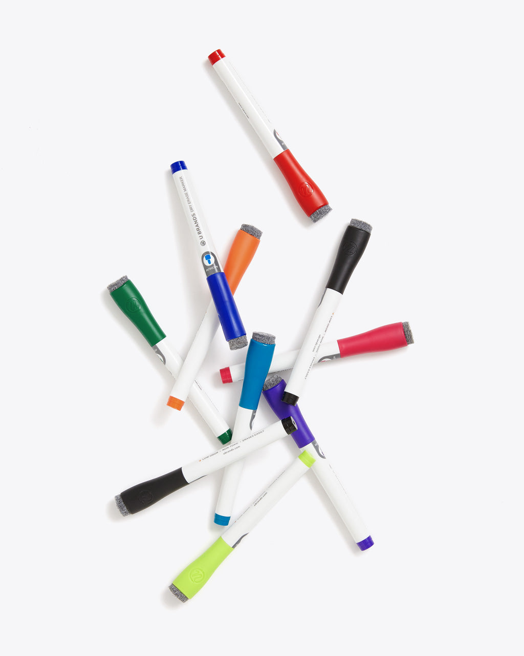 scattered assortment of dry erase markers