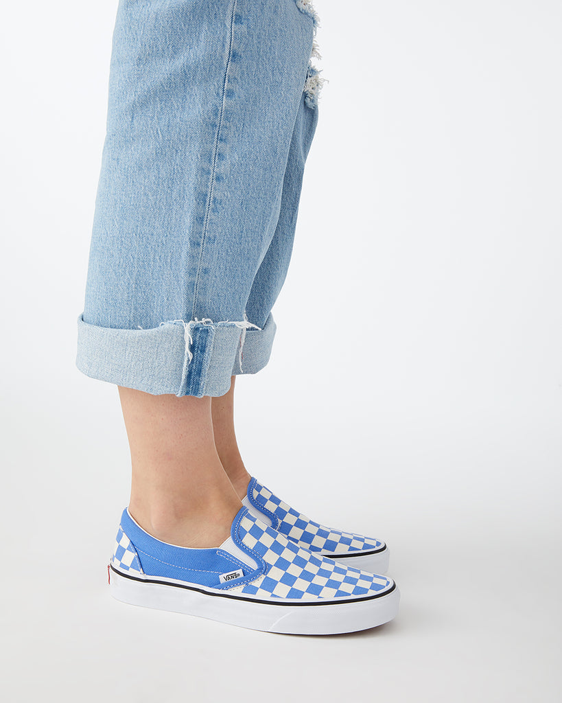 Classic slip ons in a blue and white checkerboard pattern.