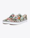 white classic vans slip ons with a tropical floral pattern