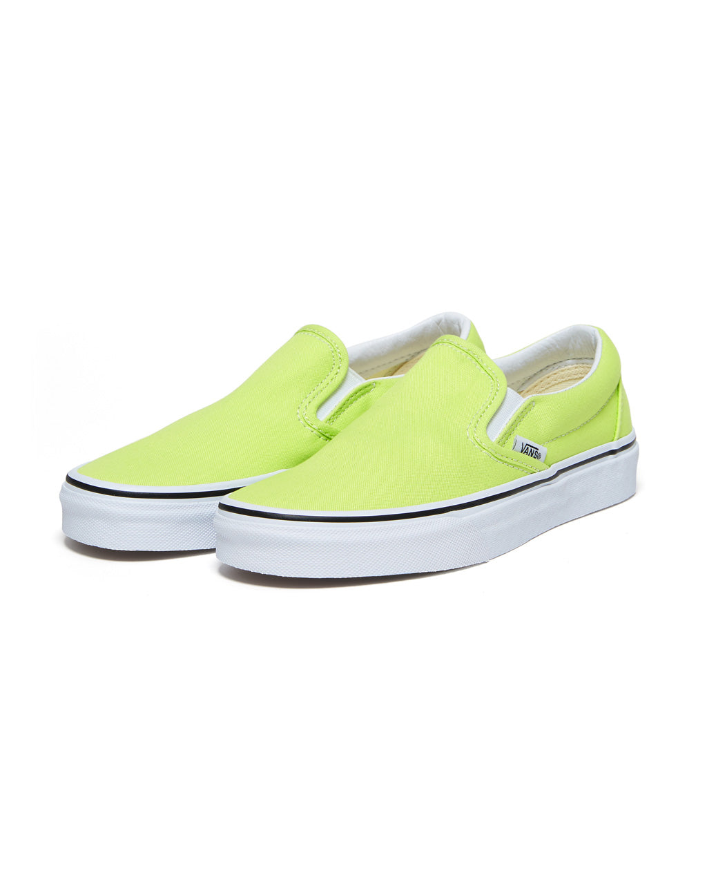 These Vans Classic Slip-On shoes come in sharp green with white outsoles.