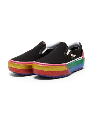 classic black slip on vans with a stacked rainbow glitter platform
