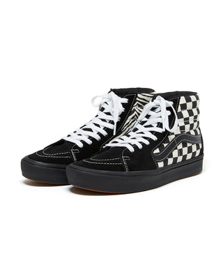 black and white high top sneakers with checkerboard and zebra print details