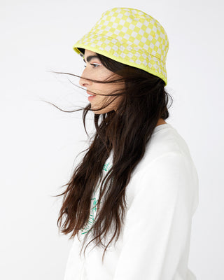 Yellow and white plaid bucket hat shown on model