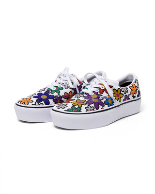 white era platform vans with a glitter daisy pattern