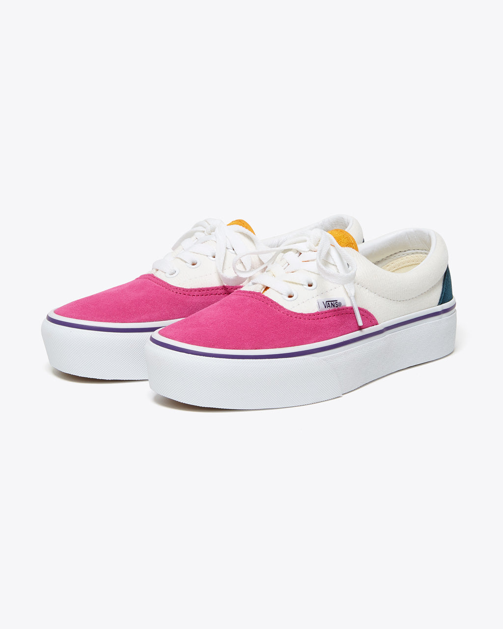 Pink, white, yellow, and navy lace-up tennis shoes with white platform sole.