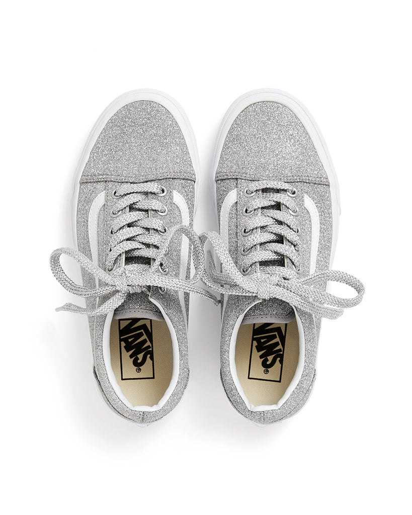 top view of silver glitter Vans sneakers with silver glitter laces, and the Vans logo on the insole