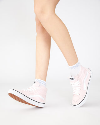 White crew socks with a white and blue checkered band at top shown with light pink high top vans