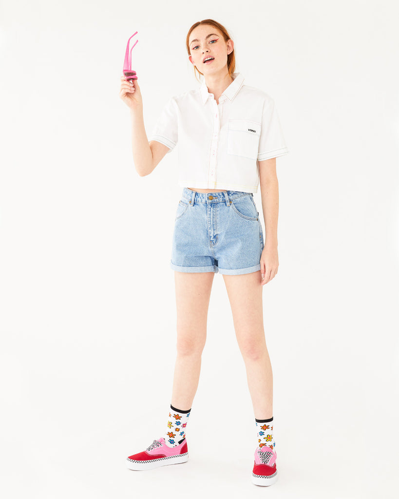 white crop button-up short sleeve shirt paired with blue jean shorts shown on model