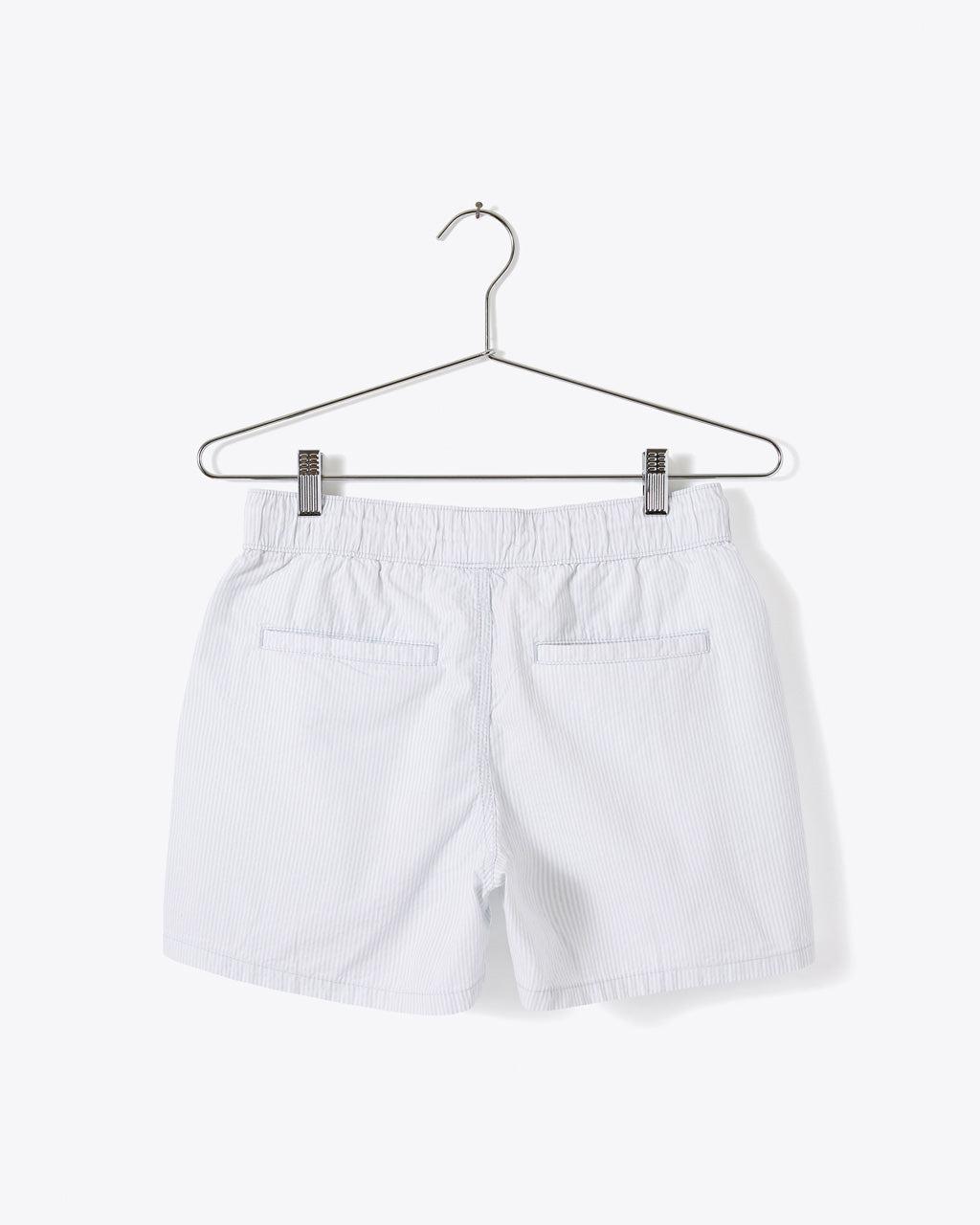 back view of ballad blue shorts with two back pockets shown on hanger