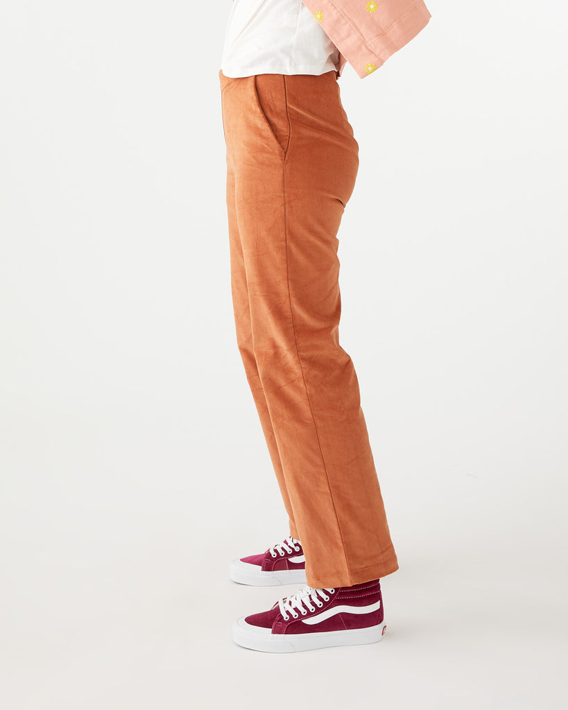 Brown corduroy trousers.