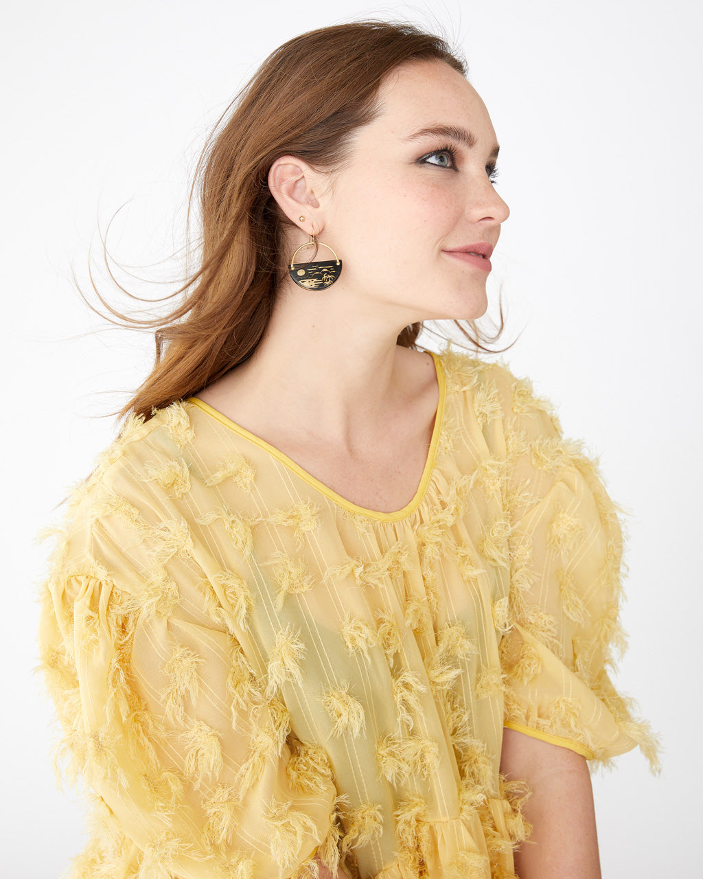 tropical earrings featured on a model wearing our yellow sister jane oversized midi dress