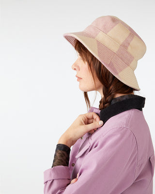 Large plaid bucket hat in pink and tan.