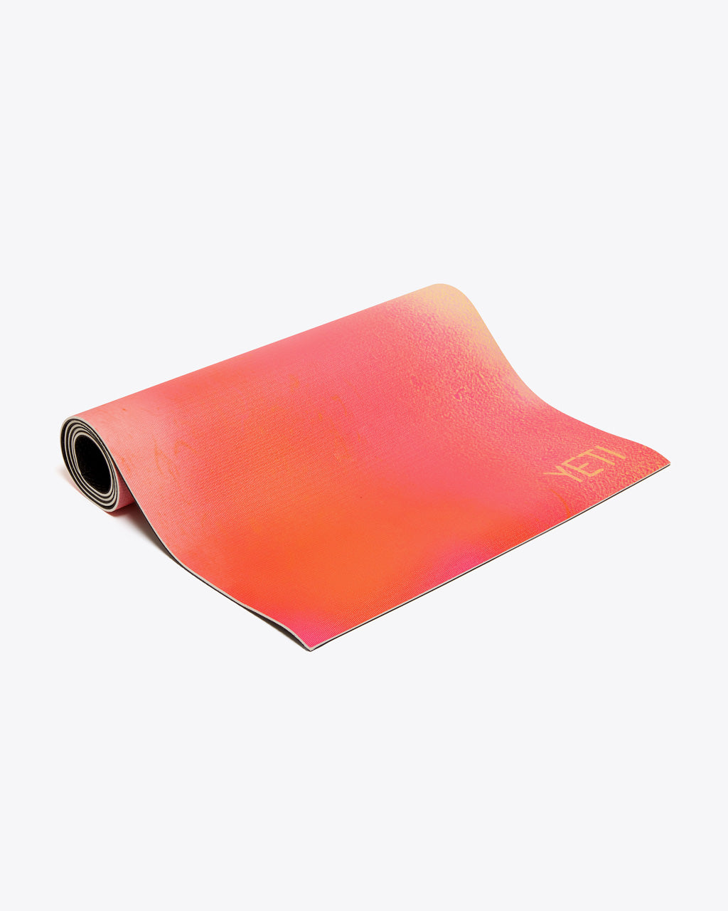 pink/red yoga mat shown almost rolled up