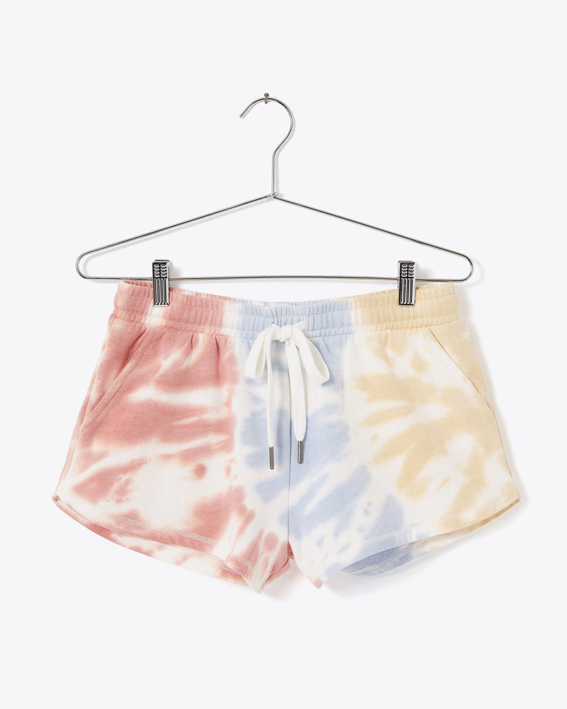 white sweat shorts with pale red, blue, yellow tie dye