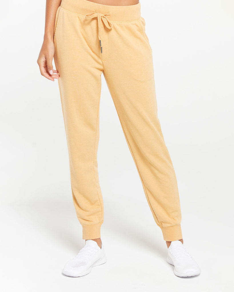 model wearing yellow jogger sweatpants with white sneakers
