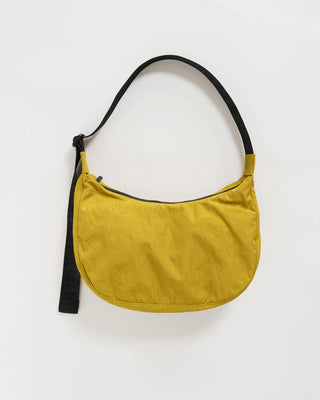 nylon crescent shaped purse with black adjustable strap in lentil yellow
