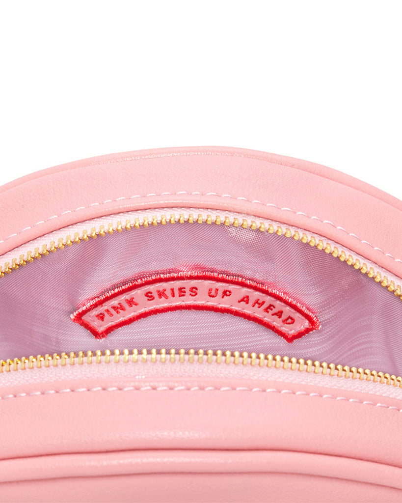 Metallic pink lamé lining with embroidered 'Pink Skies Up Ahead' internal patch.