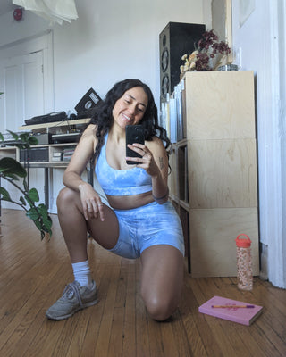 model taking a selfie wearing balian crop in blue tie dye with matching bike shorts