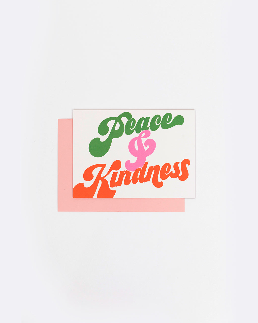 white card with the words peace and kindness