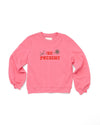 pink balloon sleeve sweatshirt with the words be present
