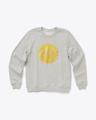 grey balloon sleeve sweatshirt with a gold sun shaped design in the middle and the words hanging out with my higher self